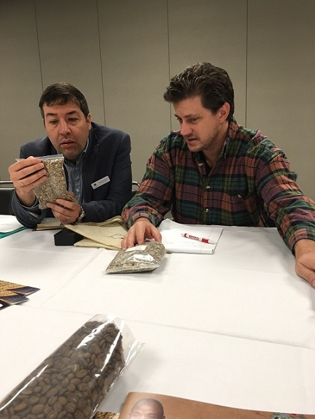 Mario Fernandez and Joel Schuler look at the coffee samples from the Philippines. They knew what was missing.
